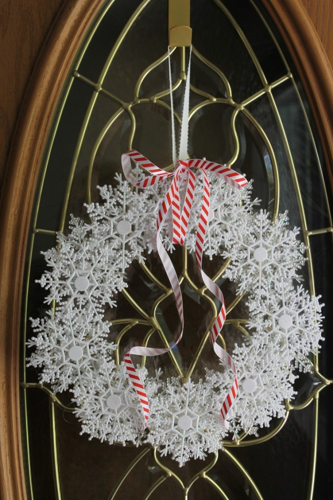 Made from 2-3 boxes of snowflake ornaments, hot glue and ribbon.