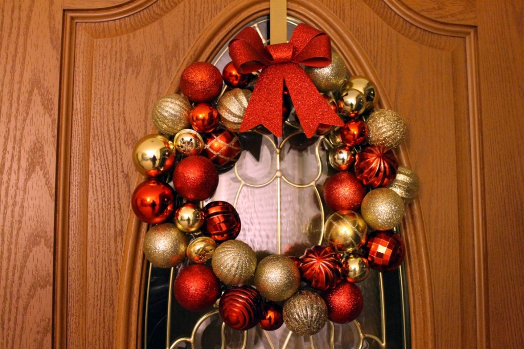 Made from Christmas bulbs, a bow and a wire hanger. Click the picture for the tutorial.